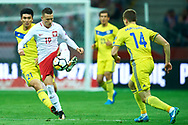 Warsaw, Poland - 2017 September 04: Piotr Zielinski from Poland fights for the ball with Roman Murtazayev from Kazakhstan during soccer match Poland v Kazakhstan - FIFA 2018 World Cup Qualifier at PGE National Stadium on September 04, 2017 in Warsaw, Poland.<br /> <br /> Adam Nurkiewicz declares that he has no rights to the image of people at the photographs of his authorship.<br /> <br /> Picture also available in RAW (NEF) or TIFF format on special request.<br /> <br /> Any editorial, commercial or promotional use requires written permission from the author of image.<br /> <br /> Mandatory credit:<br /> Photo by © Adam Nurkiewicz / Mediasport