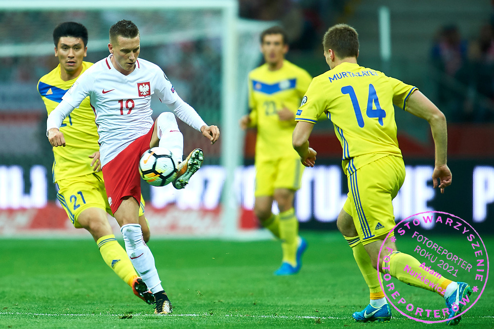Warsaw, Poland - 2017 September 04: Piotr Zielinski from Poland fights for the ball with Roman Murtazayev from Kazakhstan during soccer match Poland v Kazakhstan - FIFA 2018 World Cup Qualifier at PGE National Stadium on September 04, 2017 in Warsaw, Poland.<br /> <br /> Adam Nurkiewicz declares that he has no rights to the image of people at the photographs of his authorship.<br /> <br /> Picture also available in RAW (NEF) or TIFF format on special request.<br /> <br /> Any editorial, commercial or promotional use requires written permission from the author of image.<br /> <br /> Mandatory credit:<br /> Photo by &copy; Adam Nurkiewicz / Mediasport