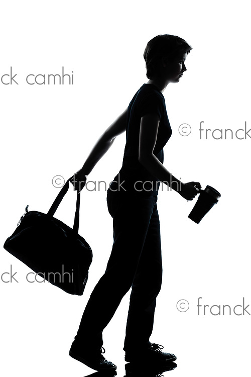 one caucasian young teenager silhouette school girl walking full length in studio cut out isolated on white background