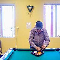 Pete Becenti racks the balls for a game of billiards at the North Side Senior Center in Gallup Thursday.
