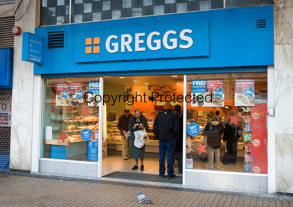 A woman leaving Greggs bakers in Broadway, Bradford.