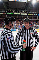 KELOWNA, CANADA - NOVEMBER 17: Linesmen Cody Wanner and Tim Plamondon stand at the bench during a time out at the Kelowna Rockets against the Lethbridge Hurricanes on November 17, 2017 at Prospera Place in Kelowna, British Columbia, Canada.  (Photo by Marissa Baecker/Shoot the Breeze)  *** Local Caption ***