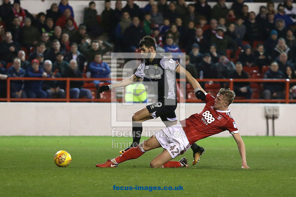 Nelson Oliveira of Norwich is through on goal but is foiled by a superb tackle from Joe Worrall of Nottingham Forest during the Sky Bet Championship match at the City Ground, Nottingham<br /> Picture by Paul Chesterton/Focus Images Ltd +44 7904 640267<br /> 21/11/2017