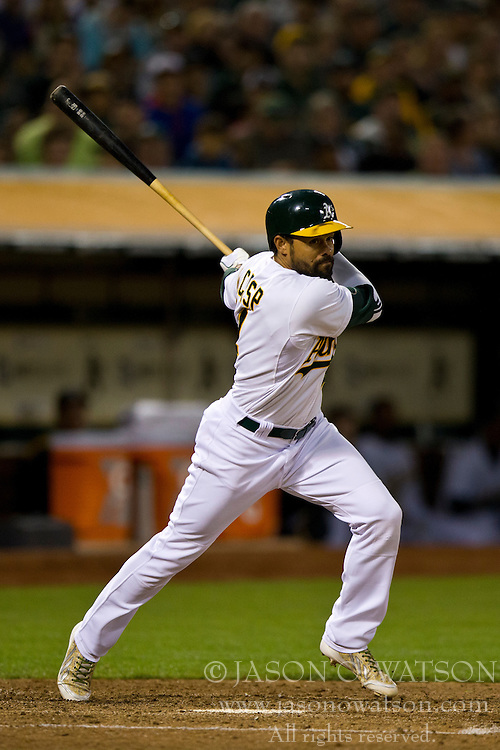 OAKLAND, CA - JULY 05:  Coco Crisp #4 of the Oakland Athletics at bat against the Toronto Blue Jays during the sixth inning at O.co Coliseum on July 5, 2014 in Oakland, California. The Oakland Athletics defeated the Toronto Blue Jays 5-1.  (Photo by Jason O. Watson/Getty Images) *** Local Caption *** Coco Crisp