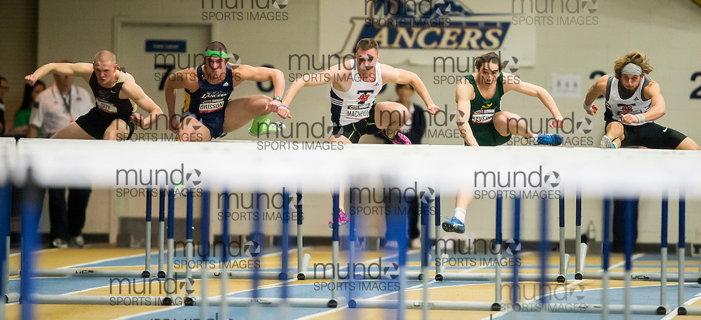 Windsor, Ontario ---2015-03-13--- Heat 2 of the 60m hurdles heats  at the 2015 CIS Track and Field Championships in Windsor, Ontario, March 13, 2015.<br /> GEOFF ROBINS/ Mundo Sport Images