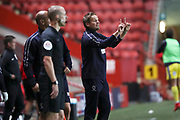 AFC Wimbledon manager Neal Ardley making hand signals during the EFL Trophy match between Charlton Athletic and AFC Wimbledon at The Valley, London, England on 4 September 2018.