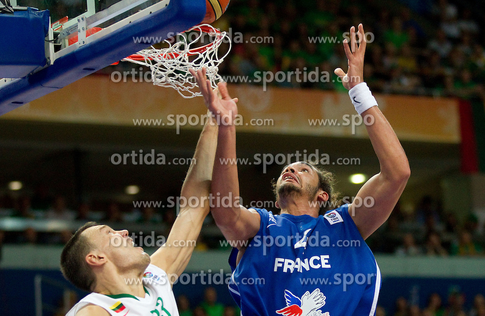 Sarunas Jasikevicius of Lithuania vs Joakim Noah of France during basketball game between National basketball teams of Lithuania and France at FIBA Europe Eurobasket Lithuania 2011, on September 9, 2011, in Siemens Arena,  Vilnius, Lithuania.  (Photo by Vid Ponikvar / Sportida)