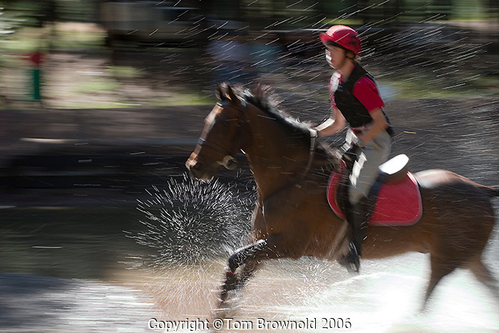 Horse show contestants in cross country race