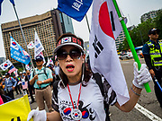 09 JUNE 2018 - SEOUL, SOUTH KOREA: A woman marches in a pro-American rally in downtown Seoul. Participants said they wanted to thank the US for supporting South Korea and they hope the US will continue to support South Korea. Many were also opposed to ongoing negotiations with North Korea because they don't think Kim Jong-un can be trusted to denuclearize or to not attack South Korea.     PHOTO BY JACK KURTZ