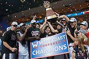 The Gonzaga men's basketball team hoists the WCC tournament trophy. (Austin Ilg photo, Gonzaga Bulletin)