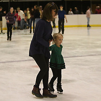 Dion Henry, left, takes Paisley Bascomb, 4, for a skate around the rink Saturday at the Bancorpsouth Arena