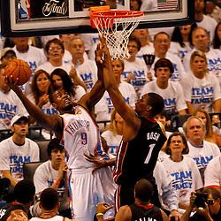 Jun 14, 2012; Oklahoma City, OK, USA; Oklahoma City Thunder power forward Serge Ibaka (9) shoots over Miami Heat small forward LeBron James (6) during the second quarter of game two in the 2012 NBA Finals at Chesapeake Energy Arena. Mandatory Credit: Derick E. Hingle-US PRESSWIRE