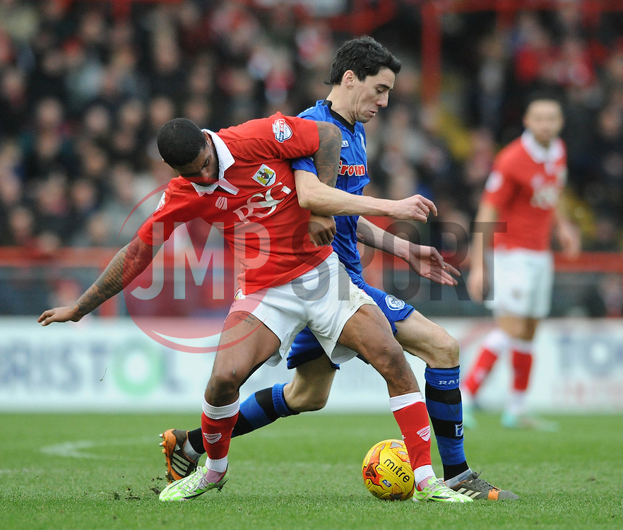 Rochdale's Peter Vincenti challenges for the ball with Bristol City's Mark Little - Photo mandatory by-line: Dougie Allward/JMP - Mobile: 07966 386802 - 28/02/2015 - SPORT - football - Bristol - Ashton Gate - Bristol City v Rochdale AFC - Sky Bet League One