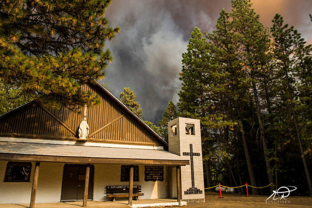 September 12, 2015 - Lake County, California. Our Lady of the Lake Church  in Loch Lomond as the Valley Fire approaches.  (Kim Ringeisen / Polaris)