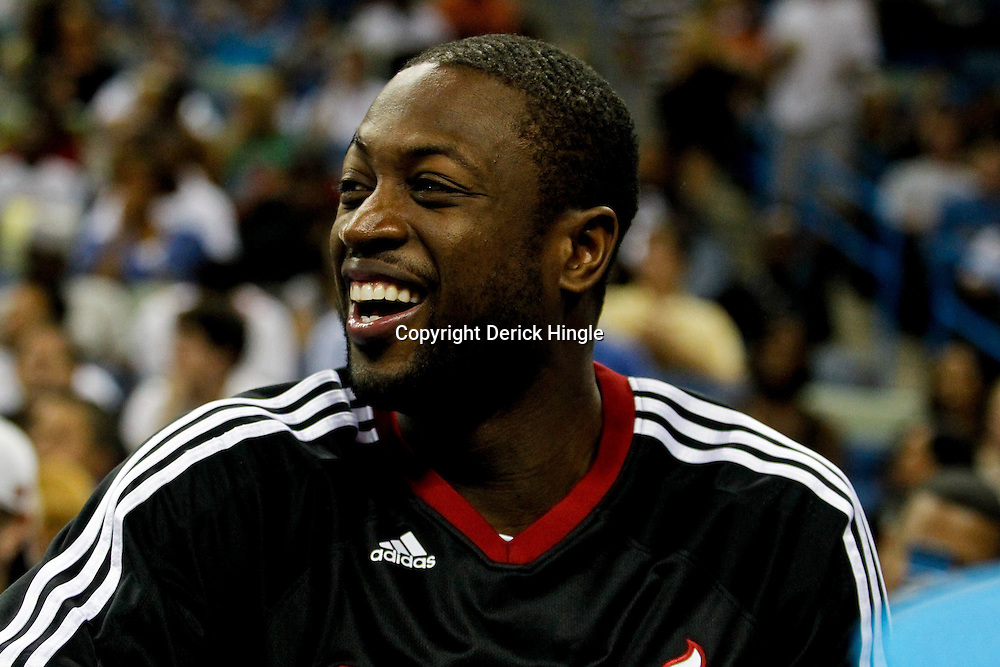 October 13, 2010; New Orleans, LA, USA; Miami Heat shooting guard Dwyane Wade (3) watches from the bench during the second half of a preseason game against the New Orleans Hornets at the New Orleans Arena. The Hornets defeated the Heat 90-76. Mandatory Credit: Derick E. Hingle
