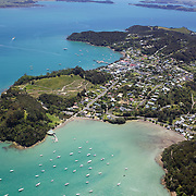 An aerial view of Russell, a small, historic seaside village on a peninsula in the eastern Bay of Islands, North Island, New Zealand. ..The Bay of Islands boasts a unique coastline sheltering over 150 small islands in its arms. Once a seafaring and whaling region the Bay of Islands is today a popular tourist destination recognised for it's cultural heritage as well as it's amazing scenery and wildlife. Small towns are scattered along the coastline. There are a lot of water-based activities, including kayaking, swimming with dolphins, game fishing and boating and whales and dolphins can often be seen in the bay. Bay of Islands, New Zealand, 16th November 2010. Photo Tim Clayton.