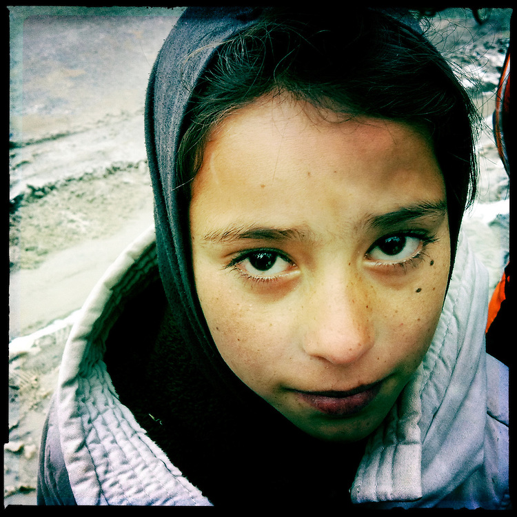 A street girl poses for a portrait.