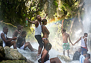 A couple celebrates at the Saut D'eau Voodoo festival in central Haiti on July 14, 2008. The appearance of a rainbow beneath the falls is said indicate that Danbala - the great lord of the waterfall - and Ayida Wedo - the rainbow - are making love. Fertility is a significant theme in the Saut D'eau ritual, attracting many couples who wish to become pregnant to the site.