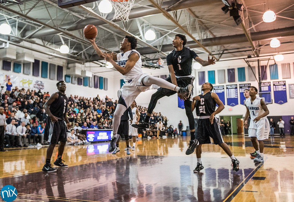 Cox Mill's Wendell Moore (0) goes up for a shot against Concord Friday night at Cox Mill High School. Concord won the game 67-62.