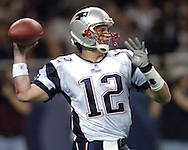 New England quarterback Tom Brady gets ready to throw the ball down field against the St. Louis Rams, November 7, 2004.