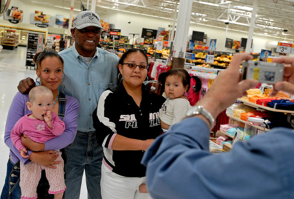 041508    Brian Leddy.Former NFL Oakland Raider Cliff Branch poses with Shannon Johnson and her daughter Jerrellynn Shirley as well Audrey Smith and her daughter Tieeanna Descheny at Wal Mart on Tuesday afternoon. Branch, who has three Super Bowl rings to his credit, was helping raise money for the Children's Miracle Network Hospital. Branch will be at Wal Mart until 9 pm Wednesday.