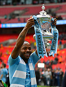 Raheem Sterling (7) of Manchester City holds up The FA Cup during the celebrations at full time during the The FA Cup Final match between Manchester City and Watford at Wembley Stadium, London, England on 18 May 2019.