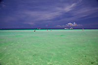 Clear tropical turquoise waters off White Sand Beach, Boracay, Philippines.
