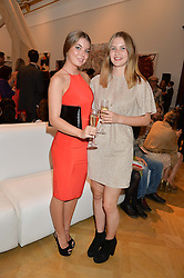 Left to right, sisters EVA GRUNDON and GRACE GRUNDON at the annual Royal Academy of Art Summer Party held at Burlington House, Piccadilly, London on 4th June 2014.