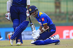 August 27, 2017 - Kandy, Sri Lanka - Sri Lankan cricketer Dinesh Chandimal reacts after the ball hit on his wrist  during the 3rd One Day International cricket match between Sri Lanka and India at the Pallekele international cricket stadium at Kandy, Sri Lanka on Sunday 27 August 2017. (Credit Image: © Tharaka Basnayaka/NurPhoto via ZUMA Press)