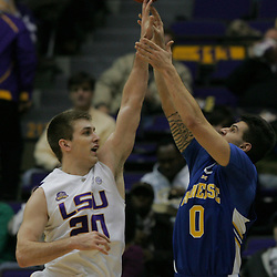 Jan 04, 2010; Baton Rouge, LA, USA;  McNeese State Cowboys guard Diego Kapelan (0) has a shot blocked by LSU Tigers guard Zach Kinsley (20) during the first half at the Pete Maravich Assembly Center. LSU defeated McNeese State 83-60.  Mandatory Credit: Derick E. Hingle-US PRESSWIRE