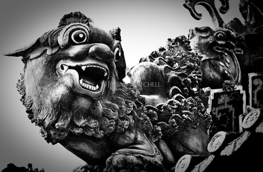 Mythical lion on Chen Family Temple is a Lingnan traditional lime sculpture