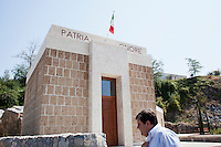 """AFFILE, ITALY - 23 AUGUST 2012: Mayor of Affile Ercole Viri, 52, stands by the mausoleum and park dedicated to fascist Marshall Rodolfo Graziani with engraved the words """"Fatherland"""" and """"Honor"""" in Affile, a town with a population of 1,600 80km east of Rome, on August 23, 2012. A mausoleum and park, dedicated to the memory of Fascist Field Marshall Rodolfo Graziani, has recently been opened in the Italian town of Affile. At a cost of €127,000 to local taxpayers, the mayor Ercole Viri has expressed hope that the site will become as 'famous and as popular as Predappio' – the burial place of Mussolini which has become a shrine to neo-Fascists. Rodolfo Graziani was the youngest colonel in the Regio Esercito (Royal Italian Army), known as the """"Butcher of Fezzan"""" and the """"Butcher of Ethiopia"""" for the brutal military campaigns and gas attacks he led in Libya and Ethiopia under the dictatorship of Benito Mussolini under which he then became Minister of Defence from 1943 to 1945."""