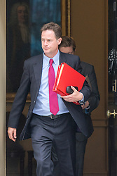 © Licensed to London News Pictures. 08/07/2014. Westminster, UK Deputy Prime Minister, Nick Clegg, leaving Downing Street today 8th July 2014 after the weekly cabinet meeting. Photo credit : Stephen Simpson/LNP