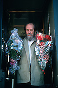 Russian Nobel prize novelist Alexander Solzhenitsyn holds flowers given him by well-wishers after arriving by train returning to his homeland June 5, 1994 in Khabarovsk, Russia. Solzhenitsyn was expelled from the Soviet Union in 1974 but returned after the fall of the Soviet Union.