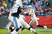 NASHVILLE, TN - NOVEMBER 29:  Derek Carr #4 of the Oakland Raiders rolls out looking to throw a pass during a game against the Tennessee Titans at Nissan Stadium on November 29, 2015 in Nashville, Tennessee.  The Raiders defeated the Titans 24-21.  (Photo by Wesley Hitt/Getty Images) *** Local Caption *** Derek Carr