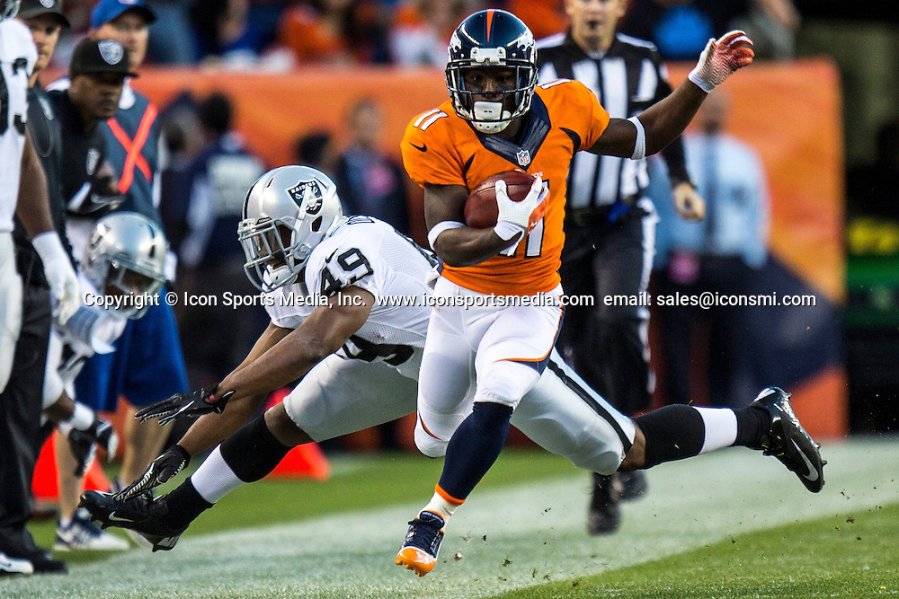 Sept. 23, 2013 - Denver, CO, USA - Denver Broncos wide receiver Trindon Holliday (11) is forced out of bounds by Oakland Raiders running back Jamize Olawale (49) during an NFL game at Sports Authority Field at Mile High Stadium in Denver, Colorado, Monday, September 23, 2013