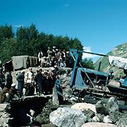 21 May 1976<br /> Close-up of Bulldozer, boulders. Spectators.