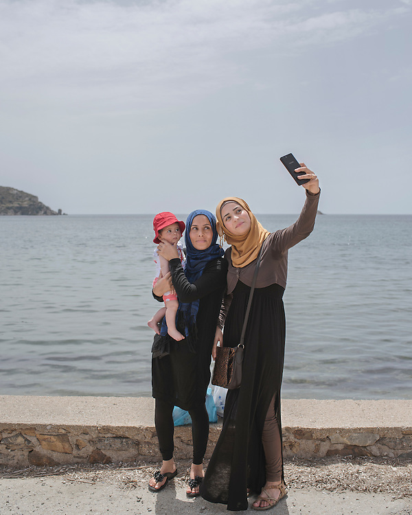 Nibal, with her baby daughter Aya, and Samah, from Syria, taking selfies at Gourna Beach. It is the first time they have been back to the sea since they were rescued by the coast guard after crossing from Turkey.