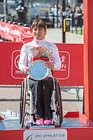 Wakako Tsuchida of Japan on the podium after the Women's Wheelchair race at the Virgin Money London Marathon 2014 at the finish line on Sunday 13 April 2014<br /> Photo: Dillon Bryden/Virgin Money London Marathon<br /> media@london-marathon.co.uk