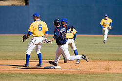 Virginia Cavaliers catcher Beau Seabury (16) rounds second base on a hit and run play against Delaware.  The Virginia Cavaliers Baseball Team defeated the Delaware Blue Hens 3-2 to complete the sweep of a three game series at Davenport Field in Charlottesville, VA on March 4, 2007.