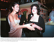 Helena Christensen & Monica Lewinsky. Vanity Fair Oscar night party. Mortons. Los Angeles. 28 March 1999. Film 99165f20<br />© Copyright Photograph by Dafydd Jones 66 Stockwell Park Rd. London SW9 0DA<br />Tel 0171 733 0108<br />www.dafjones.com