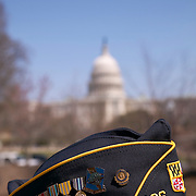 Retired soldier wearing American Legion Post 136 Greensbelt MD cap and medals with the United States Capitol Building in background, Washington DC USA<br />