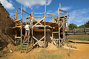 Builders climbing up the scaffolding erected in the moat trench, at the Chateau de Guedelon, a castle built since 1997 using only medieval materials and processes, photographed in 2017, in Treigny, Yonne, Burgundy, France. The Guedelon project was begun in 1997 by Michel Guyot, owner of the nearby Chateau de Saint-Fargeau, with architect Jacques Moulin. It is an educational and scientific project with the aim of understanding medieval building techniques and the chateau should be completed in the 2020s. Picture by Manuel Cohen