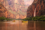 Rafting the Colorado River through the Grand Canyon with a waterfall.