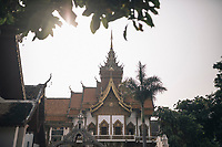 Chiang Mai, Thailand -- May 22, 2017: The early morning sun coming over Thunjai Buddhist Temple in Chiang Mai, Thailand.