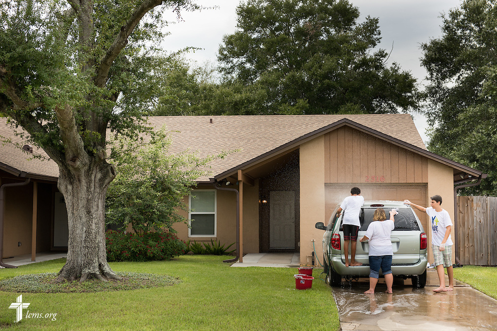 Y4Life student volunteers (L-R) Michael Luxamma, Rachael Mathis, and Eli Gill wash the house van at Redeeming Life Maternity Home during a Y4Life servant event on Saturday, Sept. 12, 2015, in Sanford, Fla. LCMS Communications/Erik M. Lunsford
