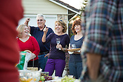 From left to right, hosts Cindi and Bob Johnson, Jan Mohundro, and Patty Bazhaw laugh during neighbor introductions during the Princess Place National Night Out party in Milpitas, California, on August 8, 2013. (Stan Olszewski/SOSKIphoto)