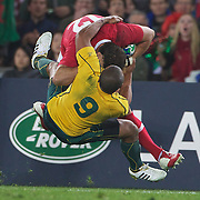 Will Genia, Australia, tackles Jamie Roberts, Wales, during the Australia V Wales Bronze Final match at the IRB Rugby World Cup tournament, Auckland, New Zealand. 21st October 2011. Photo Tim Clayton...