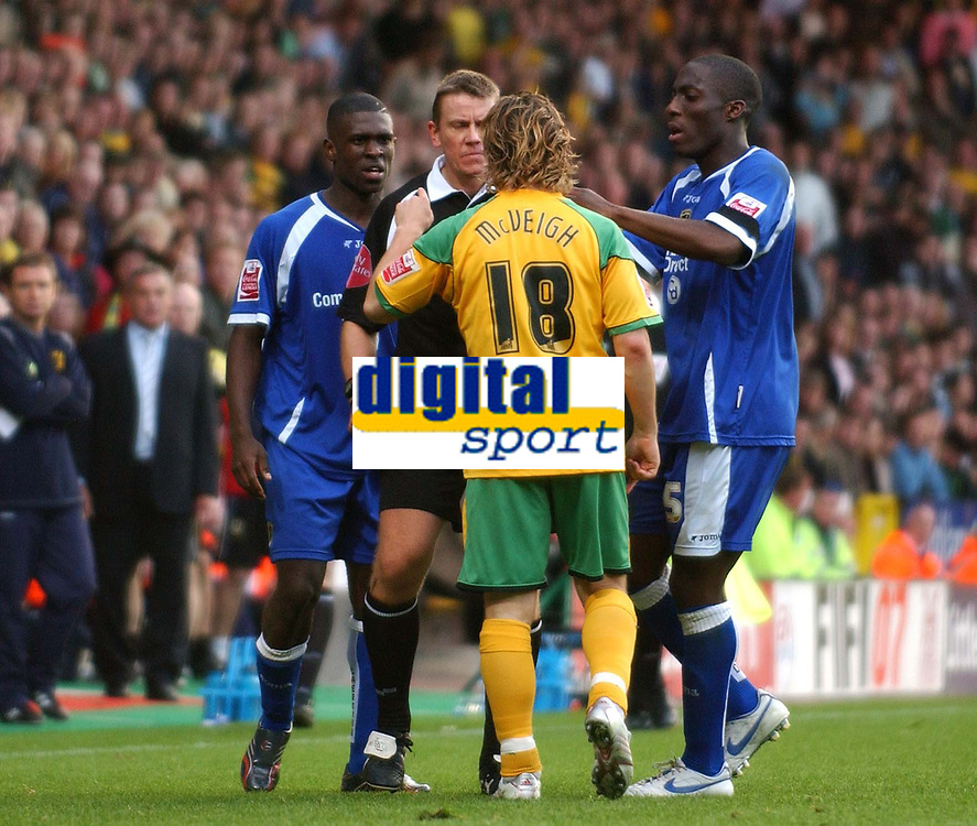 Photo: Ashley Pickering.<br />Norwich City v Cardiff City. Coca Cola Championship. 21/10/2006.<br />Cardiff's Kerrea Gilbert (blue) and Norwich's Paul McVeigh (yellow) are seperated by the ref after Gilbert kicked McVeigh,