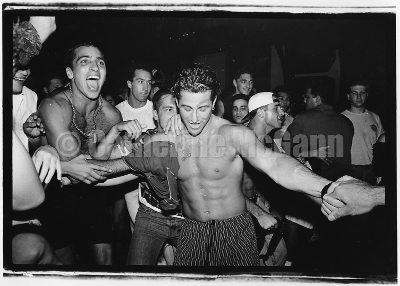 1990's:  A group of shirtless men dance at the Friday night Techno party at Limelight nightclub in New York City.